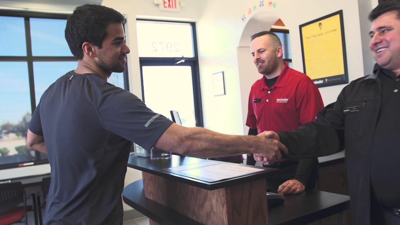 Mark Shakes Hand With Customer