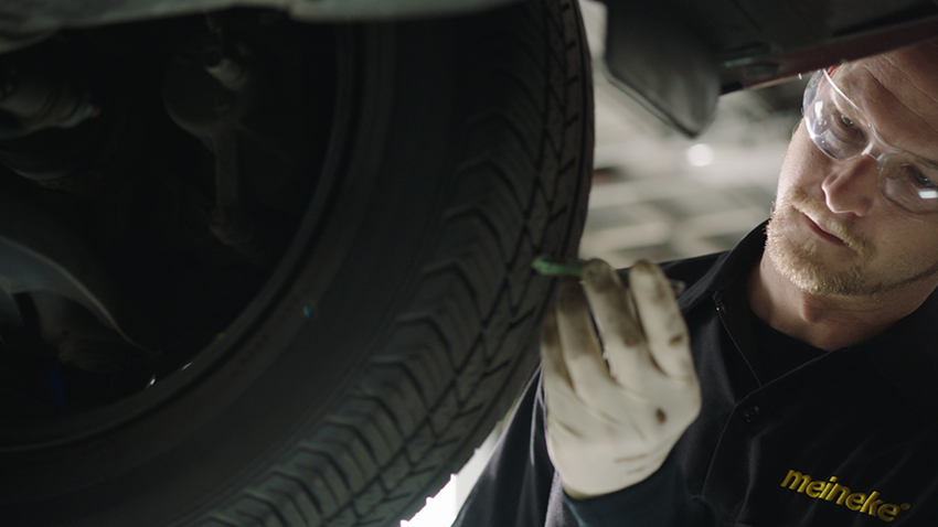 Mechanic checking tire