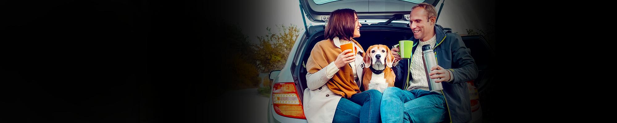 people drinking coffee in car